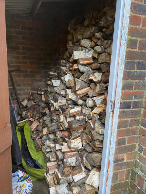 Gardener turfing job log pile